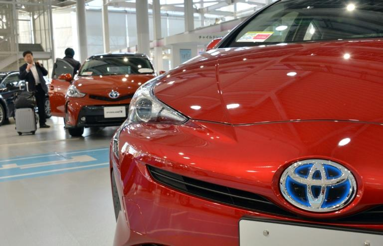Toyota lifts earnings forecast on strong Q3
