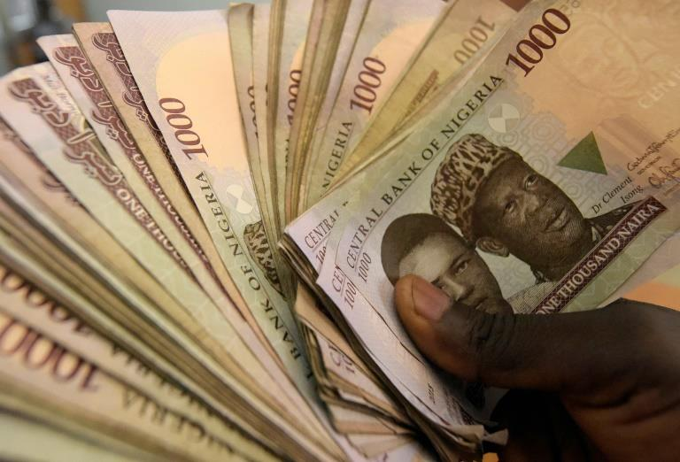 Nigeria central bank floats embattled naira currency